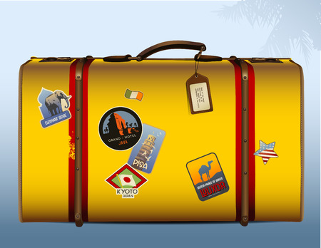 yellow suitcase with stickers