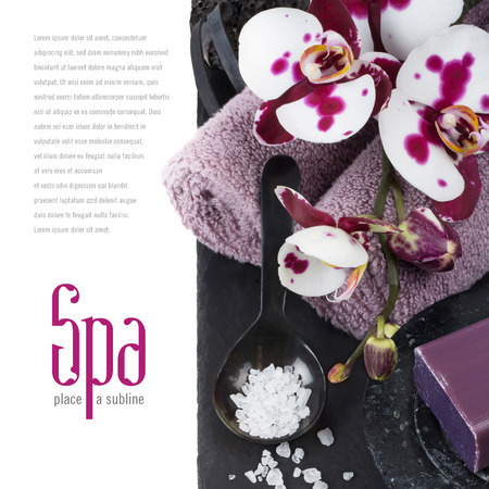 beauty parlor: elegant dark spa conceptbackground with towels, soap, bath salt and orchid flowers