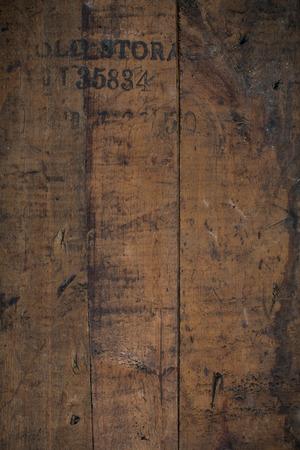 stamped: old storage  distressed wooden background