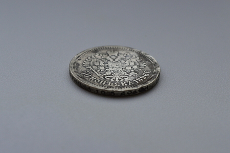 old silver coin on a white background Banco de Imagens