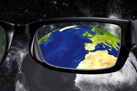 View through glasses of planet earth in color