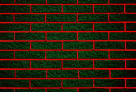 Brick wall of green bricks with a red seam Stock fotó