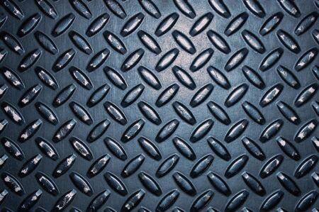Dark metal background, corrugated metal sheet in detail