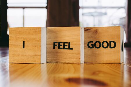 Wooden cubes with the words I FEEL GOOD in detail