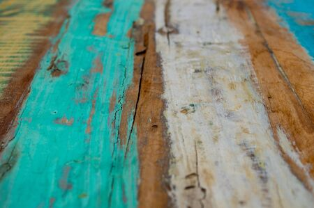 Background from old boards with multi-colored paint close up