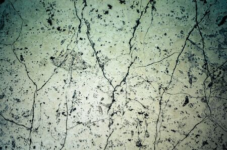 Old cracked white marble slab in detail
