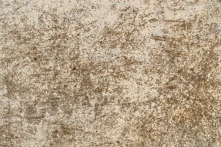 Background from an old shabby wall with peeled paint close up