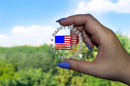 Female hand holds Independence Day icon close up