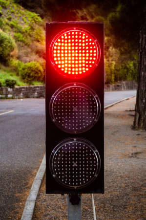 Traffic light with red light on close up in detail
