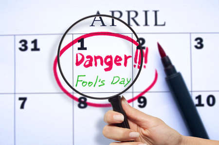 The date of April 1 is circled on the calendar close up. April fool's day