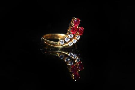Jewellery diamond ring and gemstone on a black background