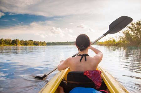 view on woman with kayak on the Amazon
