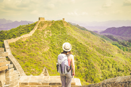 Girl watchin great wall by Jinshanling in China