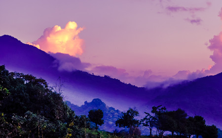 View on Purple morning fog in the mountains by Mica in Colombia