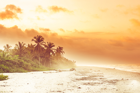 marta: View over sunset over tropical beach by Palomino in Colombia