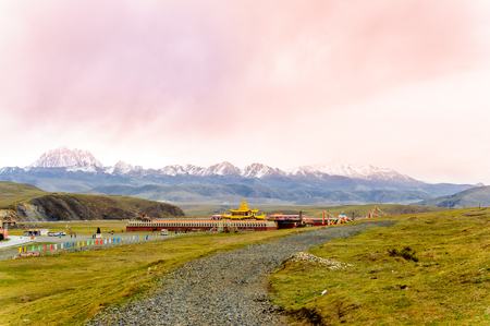 View on golden Muya Pagode by Tagong grassland in Sichuan