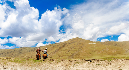 View on Horse Trekking in the mountains in China by Mount Yala