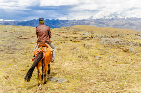 tibetan house: View on Horse Trekking in the mountains in China by Mount Yala