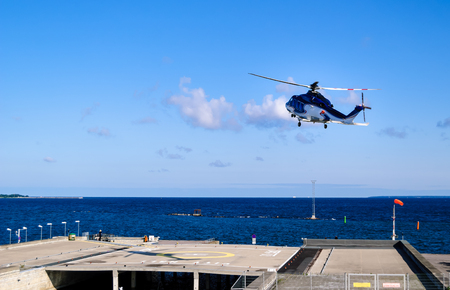 view on helicopter starting from helipad By Tallinn - Baltic sea Stock Photo
