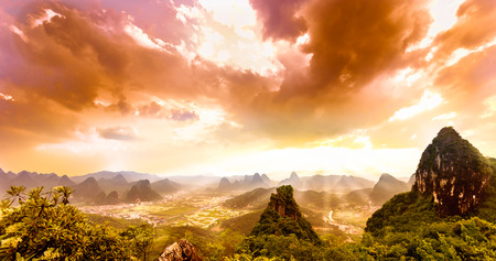View on sunset over karst landscape from moon hill in yangshuo
