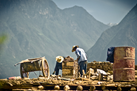 View on construction worker building house in China Stock Photo