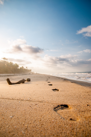 View on foodsteps and sunset on the beach by Tayrona in Colombia