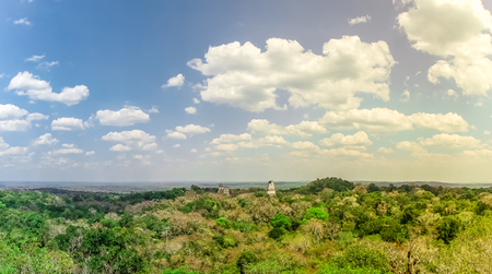 View over rain forest and ruins of Tikal in Guatemala Stock Photo