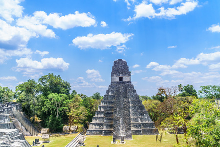 view over Maya pyramids and temples in national park Tikal in Guatemala Stock Photo