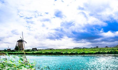View on historical windmills by Kinderdijk - Netherland Stock Photo