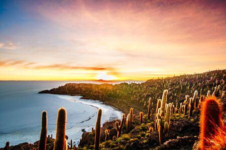 View on sunrise over island incahuasi by salt lake Uyuni in Bolivia Stock Photo