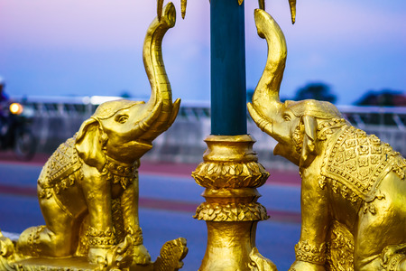 View on golden elephant statue on bridge by Chiang Rai - Thailand