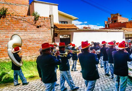 Cocacabana, Bolivia 30th April 2017: View on group of local people celebrating parade and playing drum 新闻类图片