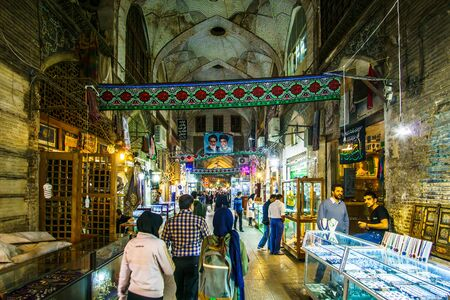 Isfahan, Iran on 31th October 2016: View on People looking onr local products in the Souk of the old town