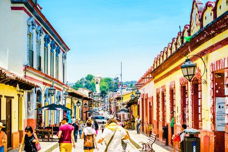 San Cristobal de las Casas, Mexico - April 27, 2016: View on Tourists walk in pedestrian street, San Cristobal de las Casas, Chiapas, Mexico