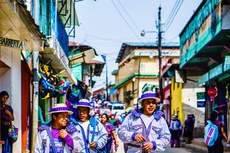 Todos Santos, Guatemala on 30th April 2016 - View on Indigenous people with traditional clothes walking in the streets of the village 新闻类图片