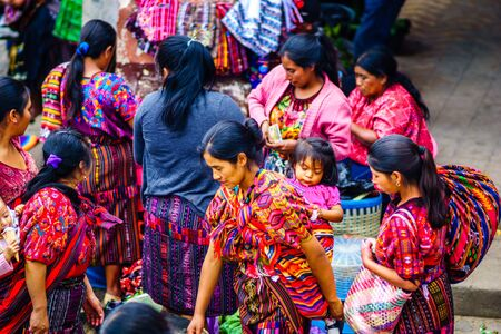 Chichicastenango, Guatemala on 2th May 2016: group of indigenous maya woman with a baby on their back on market in Chichicatenango 新闻类图片