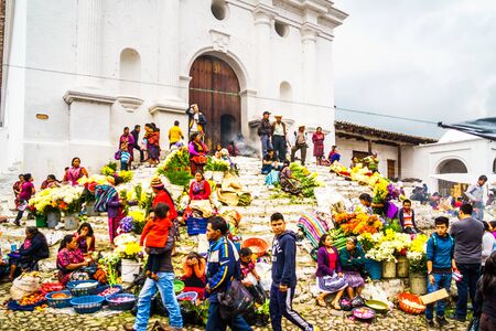 Chichicastenango, Guatemala on 2th May 2016: View on group of indigenous people selling products in front of church