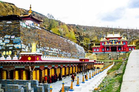 Tagong village Heping Fahui, China on 12th May 2015 - Tibetan monastery and prayer wheels