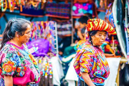 Chichicastenango, Guatemala on 2th May 2016: View on old woman wearing colorful clothes on maya market in Chichicatenango
