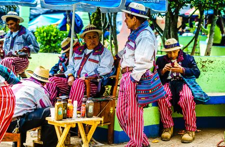 Todos Santos Cuchumatan, Guatemala on 30th April 2016 - View on Indigenous people with traditional clothes talking each other in the village 免版税图像 - 142308248