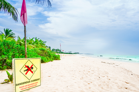 Sign at tropical beach next to Tangalle warning of rough sea Stock Photo