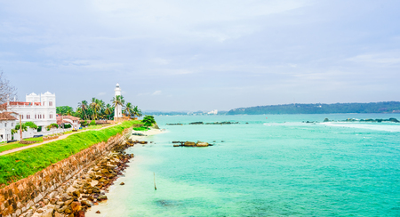 Lighthouse And Palm Trees In The Town Of Galle, Sri Lanka Stock Photo