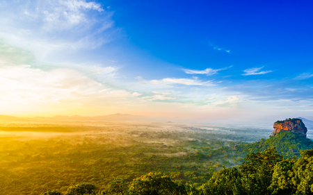 Sunrise view to Lion Rock - from mountain called Pidurangala Rock in Sri Lanka