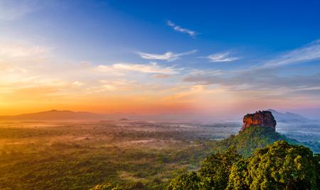 Sunrise view to Lion Rock from rock called Pidurangala in Sri Lanka