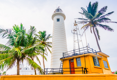 View on Lighthouse And Palm Trees In The Town Of Galle, Sri Lanka Stock Photo