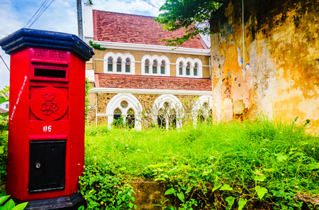 View on red post box in front of All Saints Anglican church in Galle, Sri Lanka