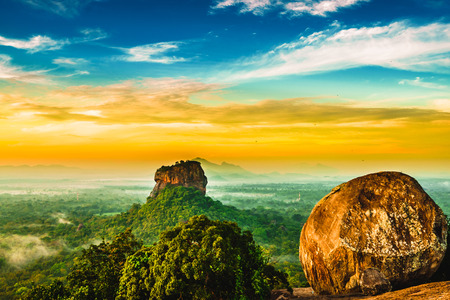 Sunrise view to Sigiriya rock from Pidurangala Rock in Sri Lanka Stock Photo