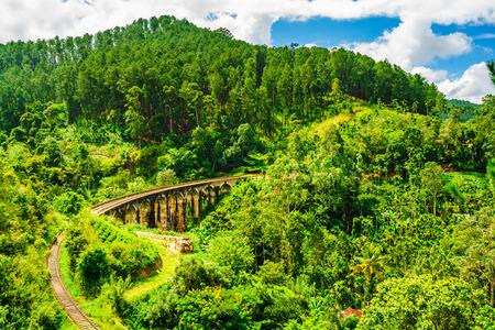 View on Train passing over Nine Arches Bridge in Ella, Sri Lanka Stock Photo