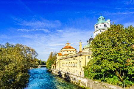 View on historic Mueller Volksbad next to Isar river - Munich Banco de Imagens