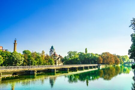 View on historic building of Mueller Volksbad of Isar river - Munich